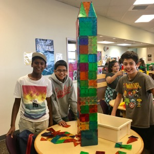 Students building with MagnaTiles